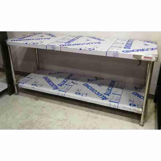 Tavolo su gambe in acciaio inox con piano di fondo profondità 650 mm 180x650 mm nuovo con graffi da esposizione